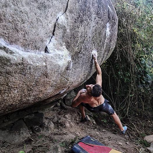 Josh campusing V9 in Puerto Rico.  Photograph by Zach Larson.