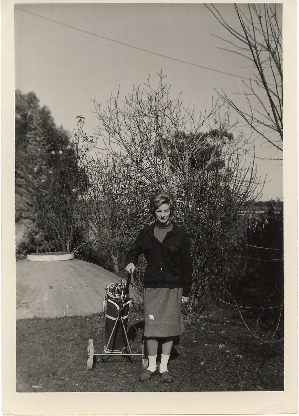 Mum in golfing attire on the farm.jpg