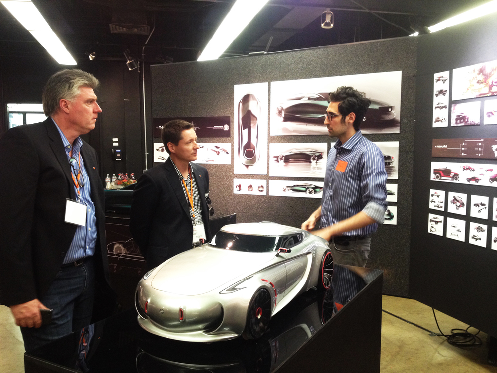 Berk Erner interviews with alumni Christopher Rhoades and Andre Frey from Mercedes-Benz.
