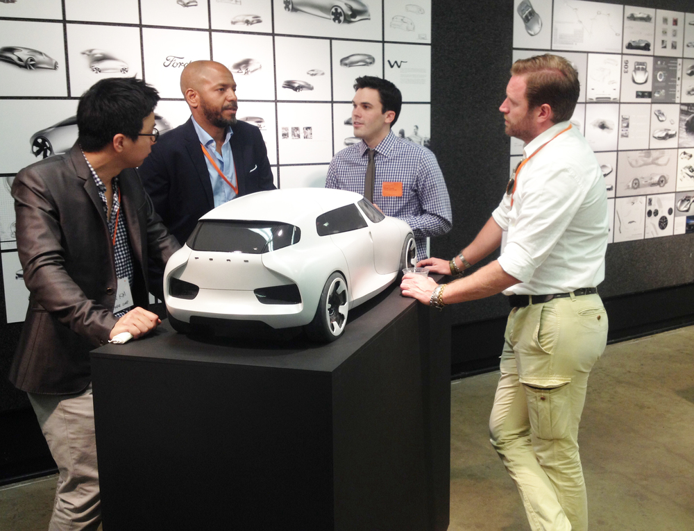 Tom Harezlak discusses his Ford internship model with design executives from the company.