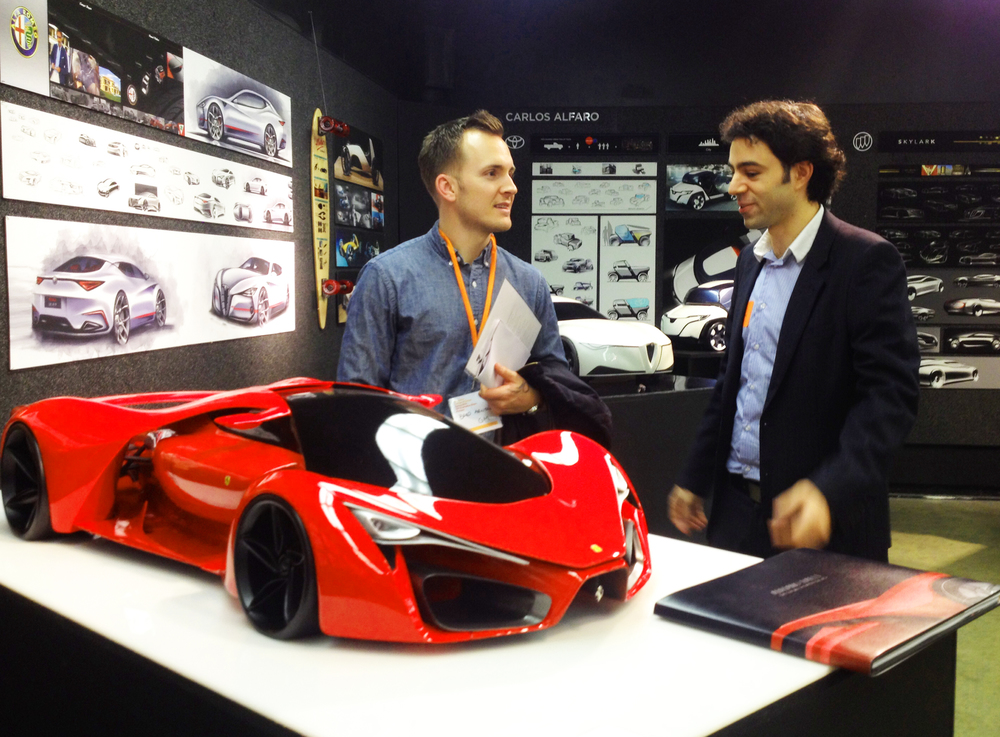 Adriano Raeli presents his Ferrari concept to alumnus Bradley Arnold of General Motors.