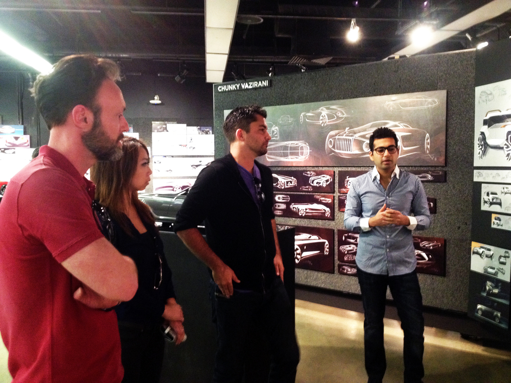Chunky Vazirani presents his work to Tim Annes and alumni Winnie Cheung and Nik Malachowski of Chrysler.