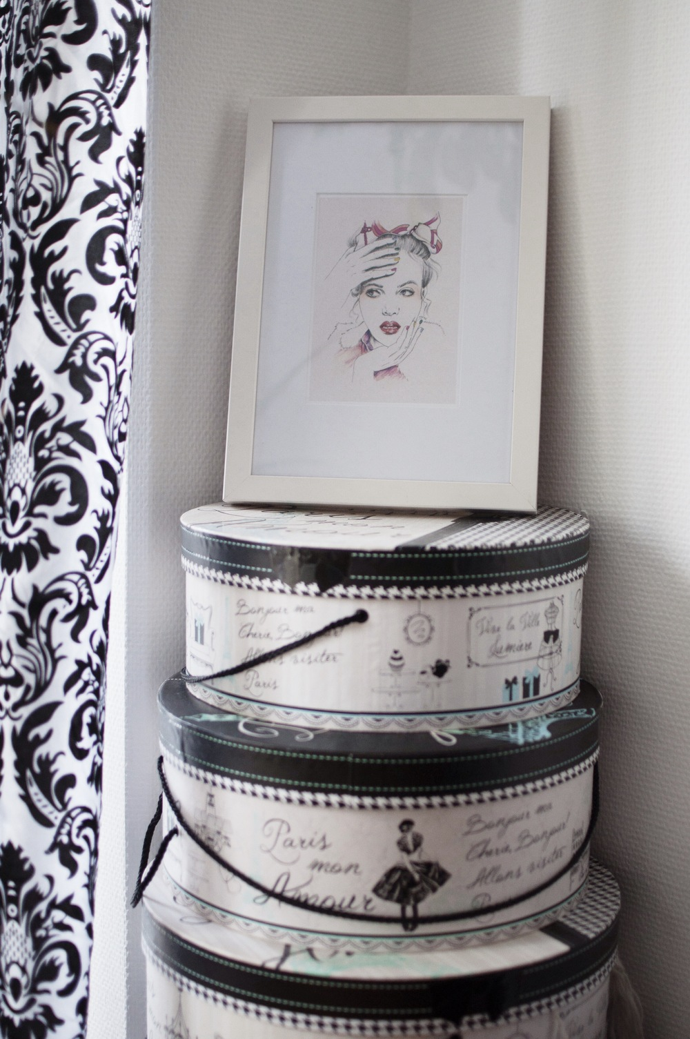 These hat boxes are my favorite storage spaces. I stored hats and other things there. I got them extremely cheap at  Brands4friends , the illustration on a frame on top, is this blog logo, created by my super talented friend Irene from Inspiration Never Ends. You may check out her work on her  Facebook  page.