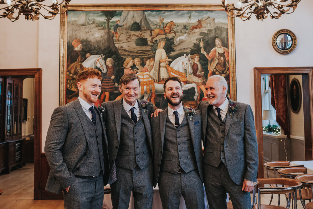 Groomsmen standing laughing