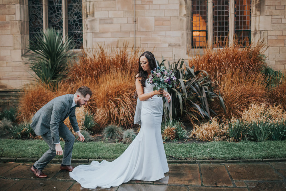 Groom fixes brides dress