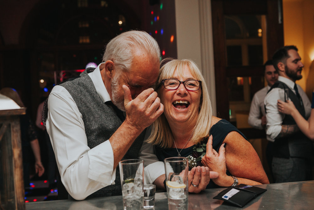 Couple laughing at bar