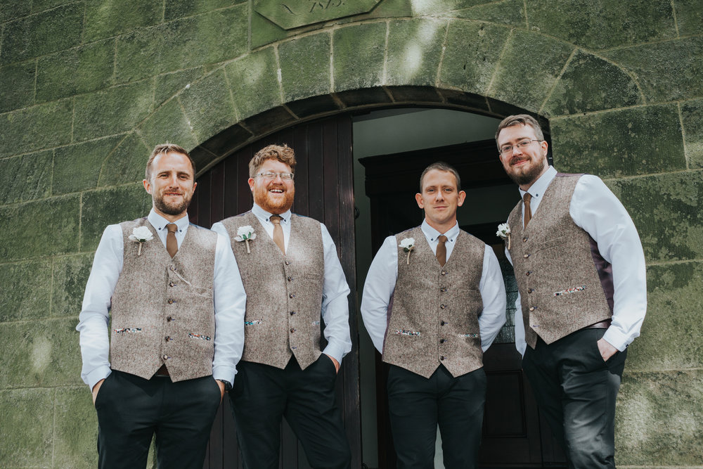 Groomsmen looking chipper outside the church door.