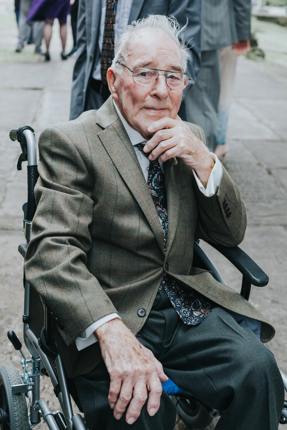 Granddad poses for photo outside church like a pro.