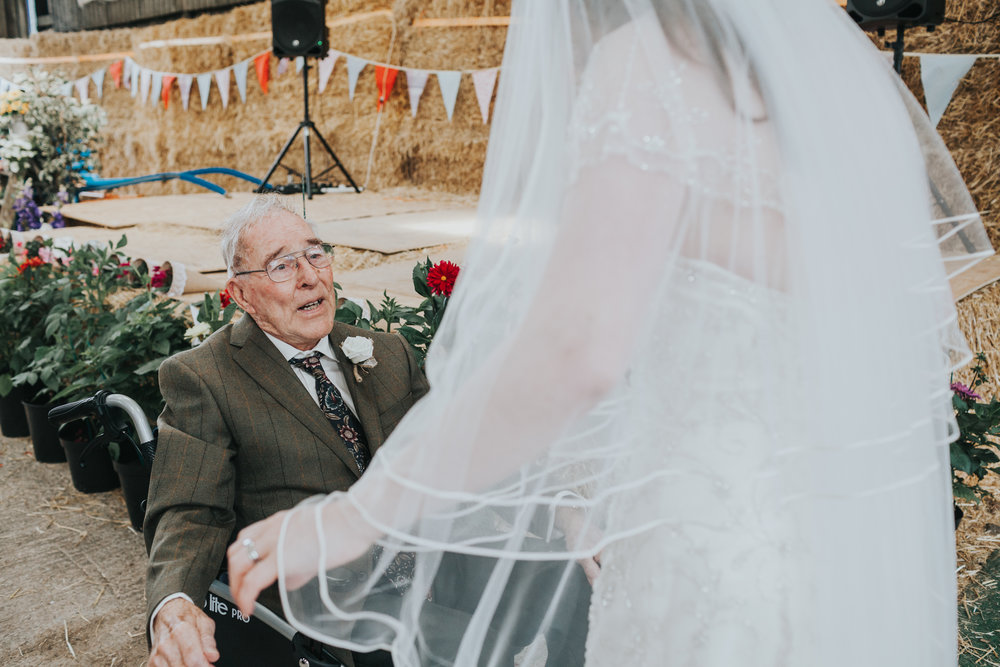 Granddad getting emotional looking at Bride in her dress.