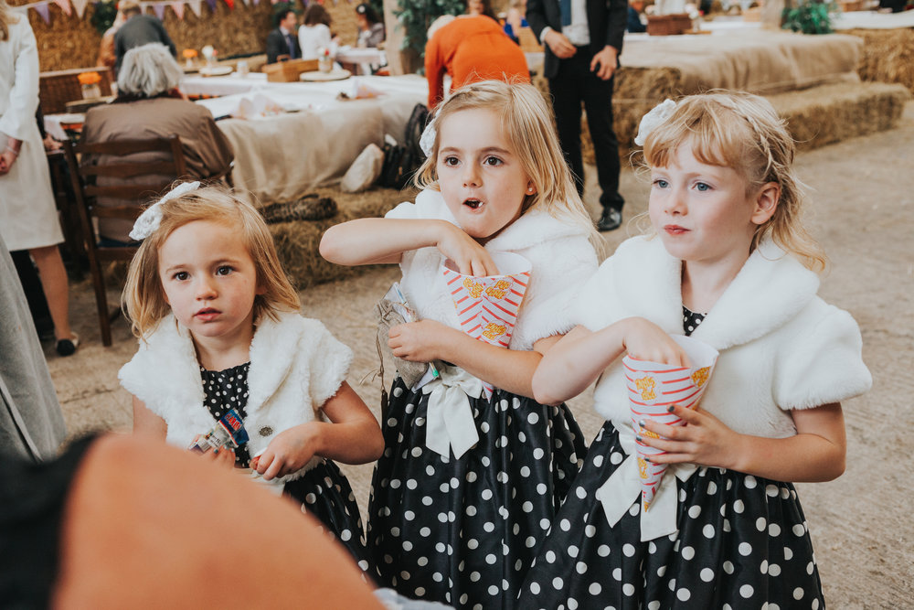 Kids eating popcorn at wedding