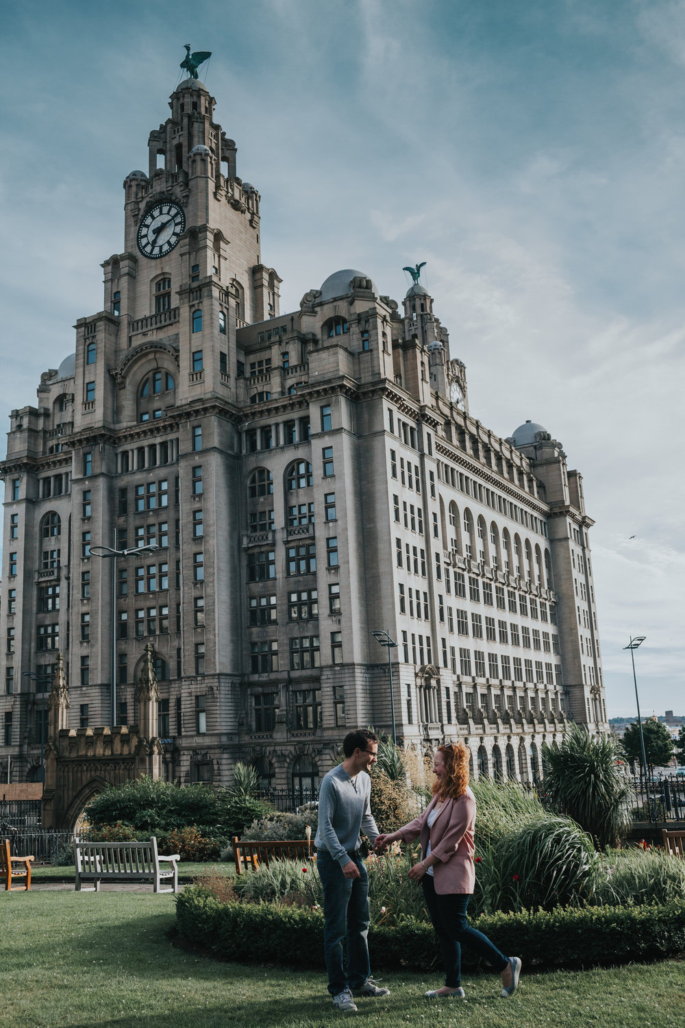 Couple in front of Liver Buildings