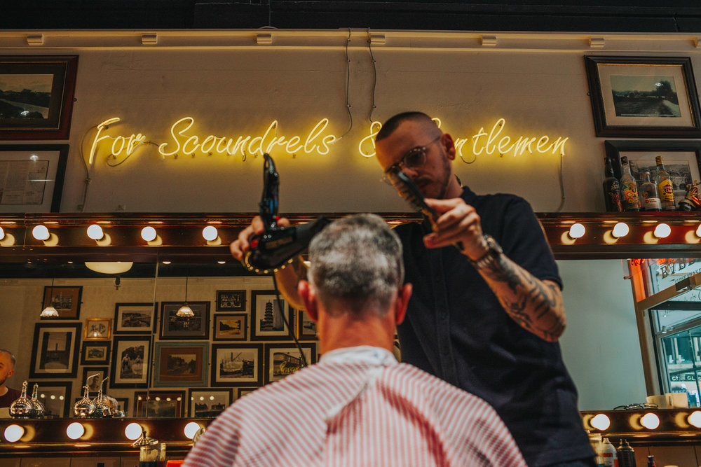 Father of the bride getting hair cut
