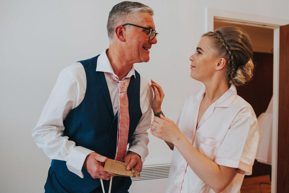 Bride and her father share a moment and she gives him a wedding morning gift.