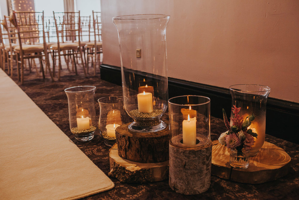 Candles decorate the floor in the room where the ceremony will take place.