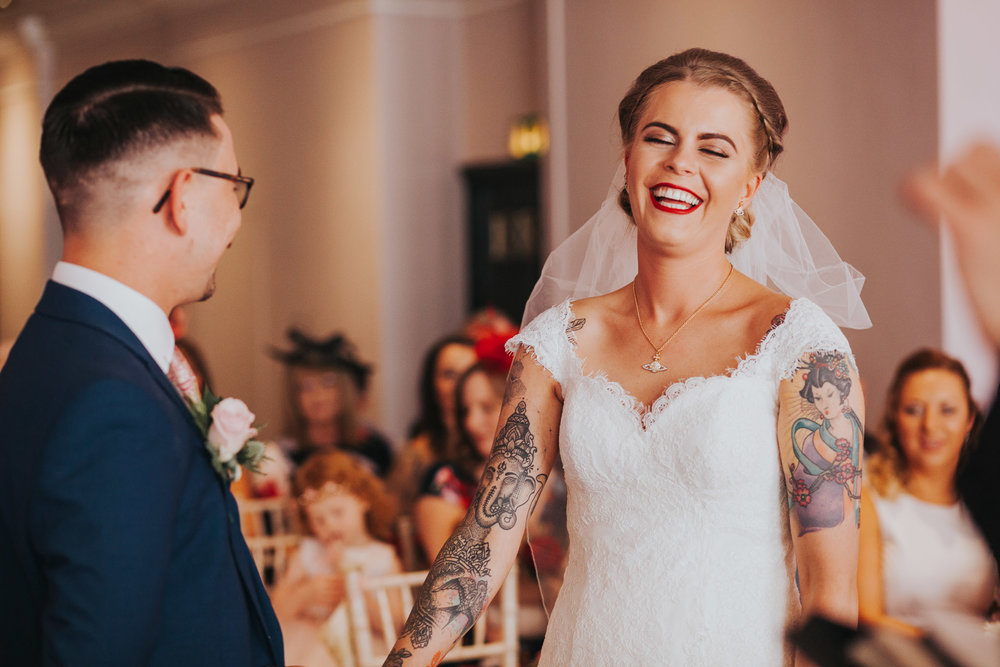 Bride laughs.