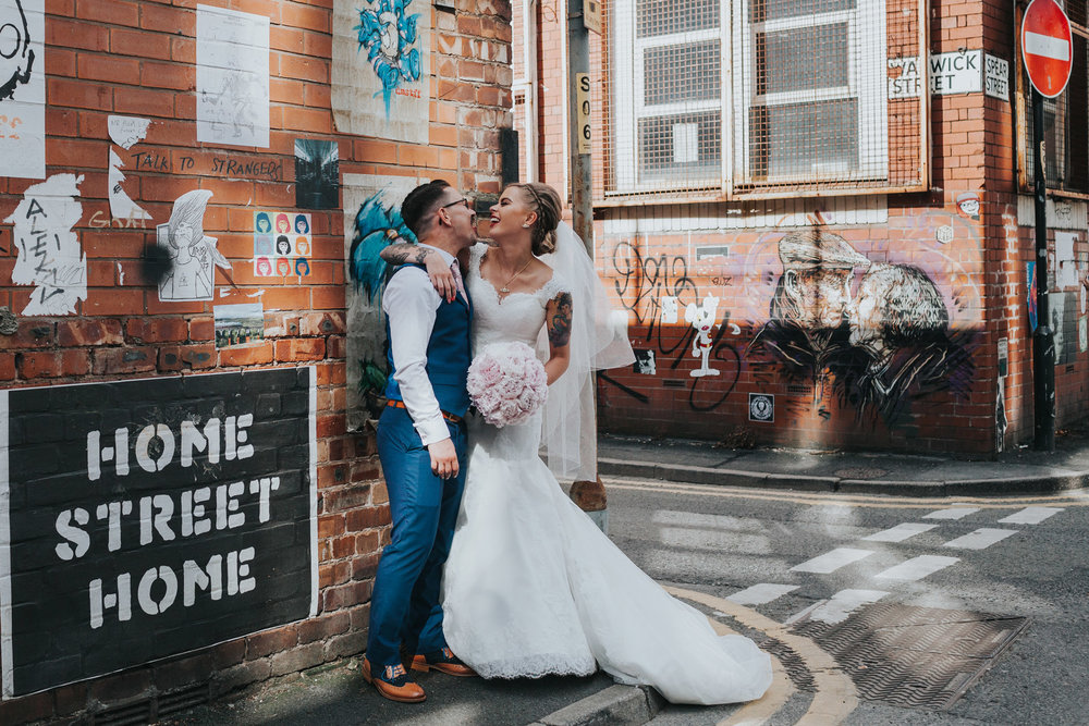 Manchester Bride and Groom pose for photographs on Warwick Street.