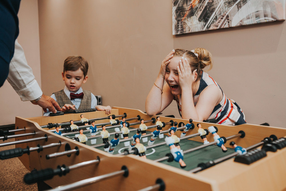 Children playing table football at wedding.