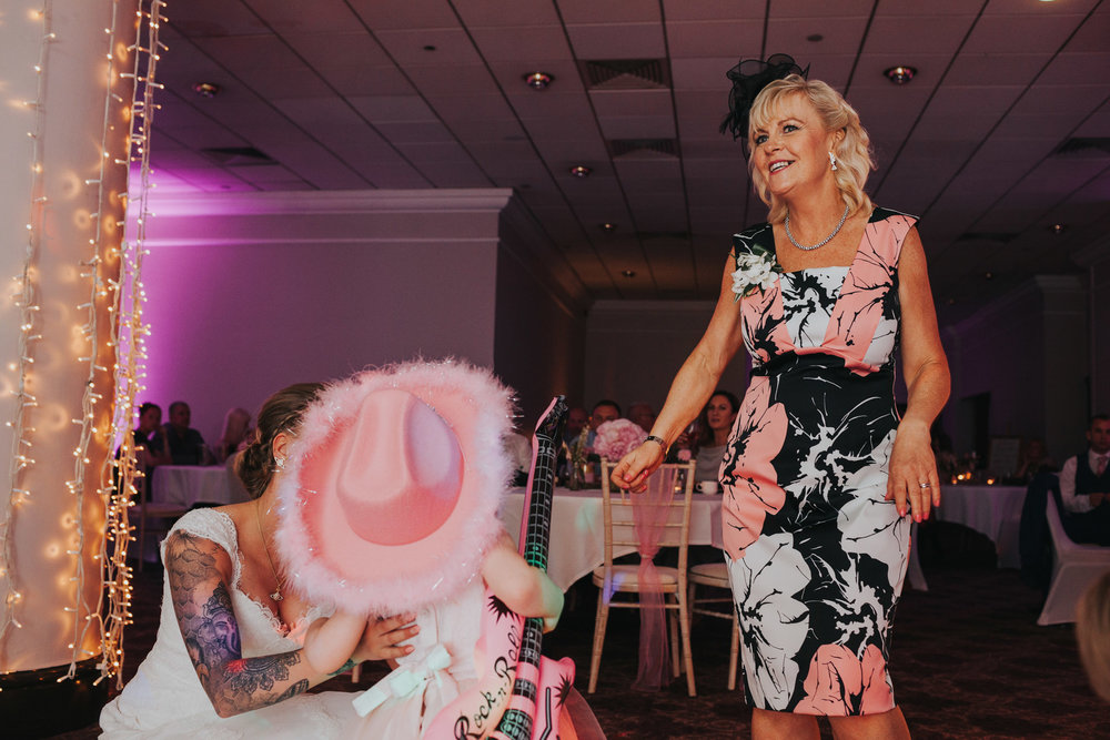 Mother of the bride dancing with flower girl.