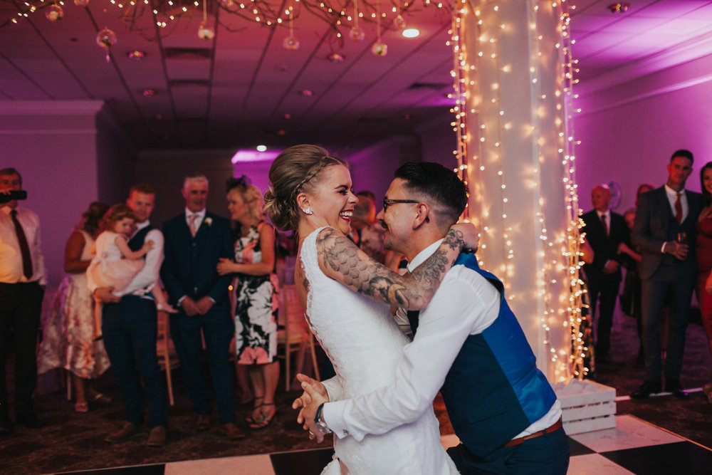 Photograph of bride and groom having their first dance together.