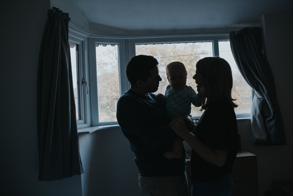 Family silhouette in bedroom window