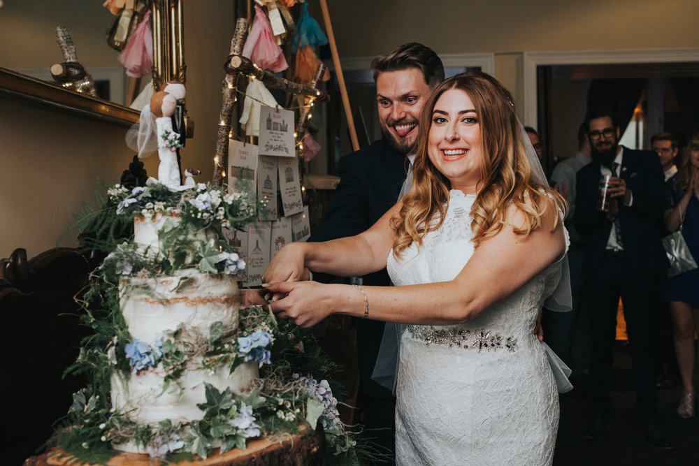 Bride and Groom Cut Wedding Cake.