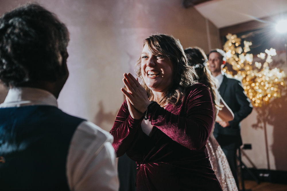 Guests smiling on dance floor.