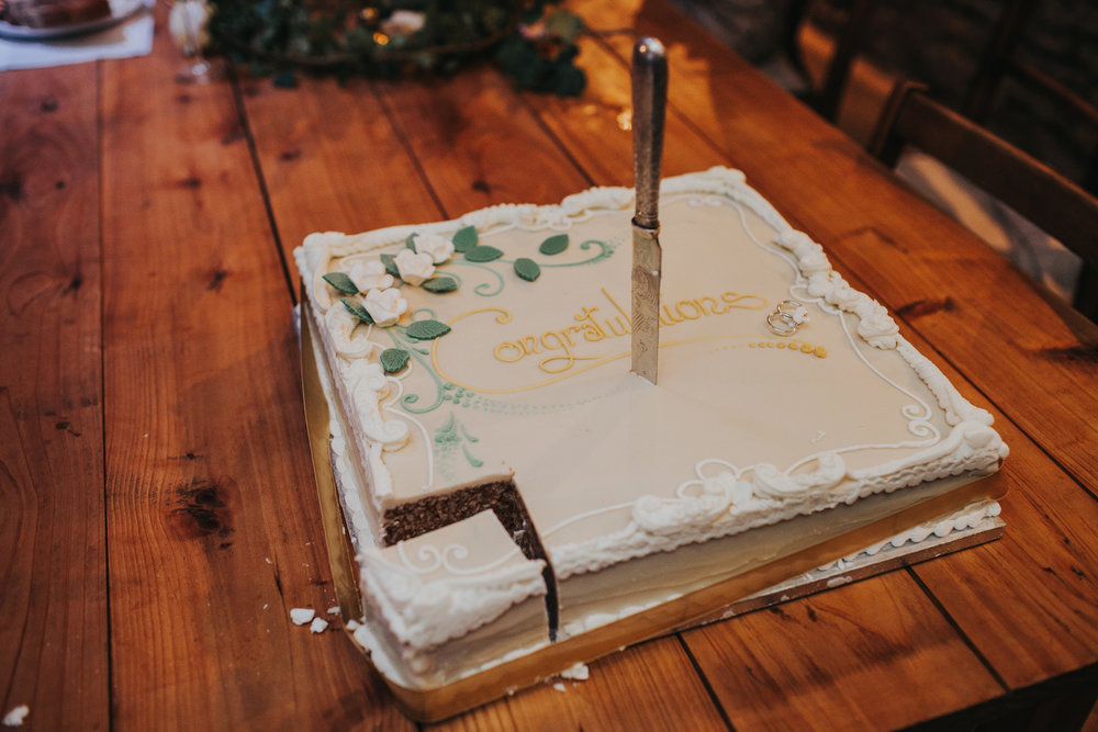Knife sticking out of cake.