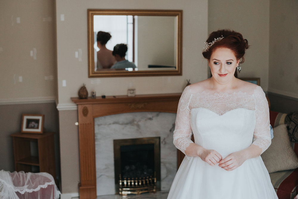 Bride smiling to herself.