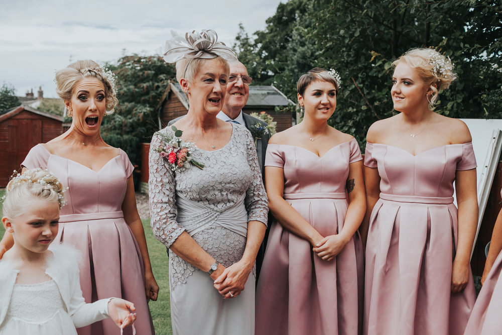 Brides mum and bridesmaids react to her wearing the dress.