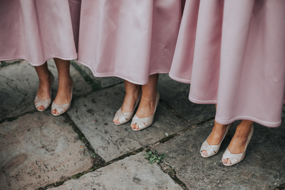 Bridesmaids pink shoes and dress.