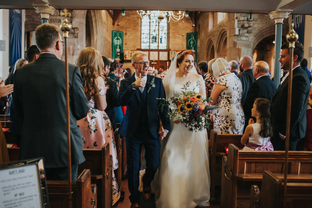Bride and groom make their way down the aisle at St Thomas's Church, Liverpool.