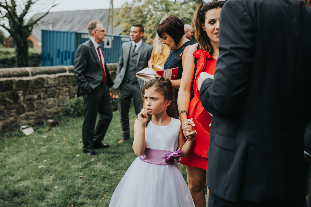 Little girl looks on at bride at St Thomas's Church Liverpool.