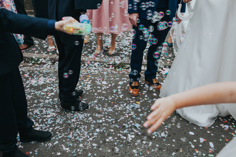 Confetti on the floor outside the church.