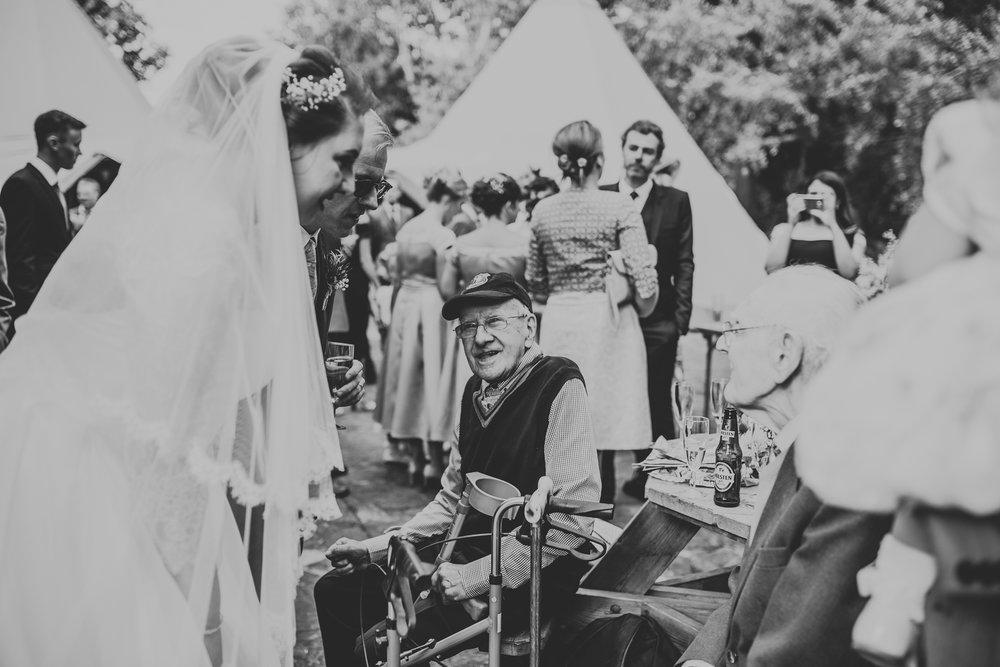 Grandad looking at Bride.