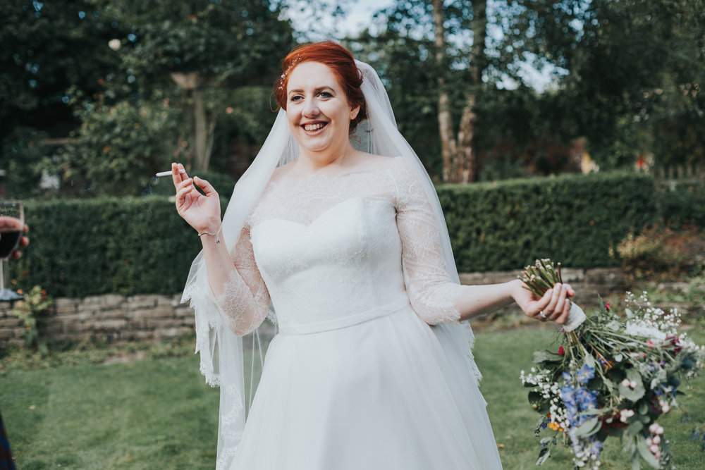Bride posing with her fag.