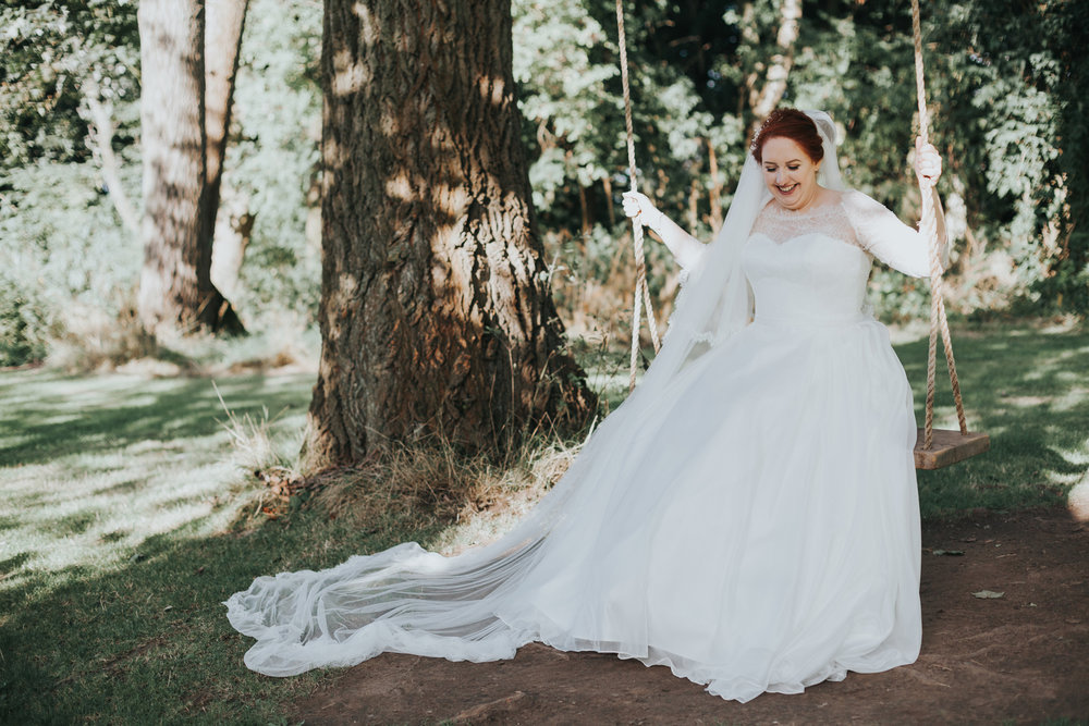 Bride on tree swing at Trafford Hall.