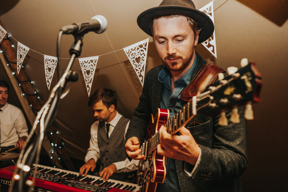 Guitarist in wedding band.