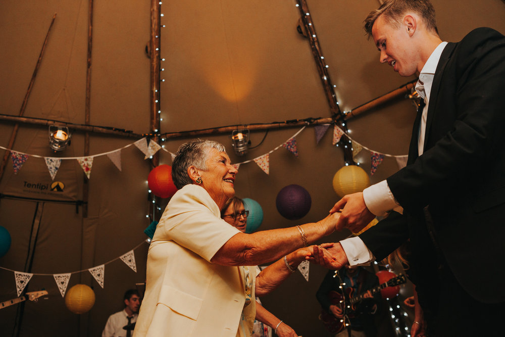 Guests dancing in tipi at Trafford Hall Wedding.