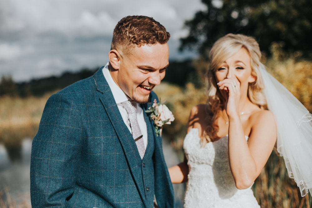 Bride and Groom laugh together.