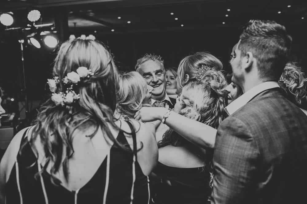 Dance floor group hug.