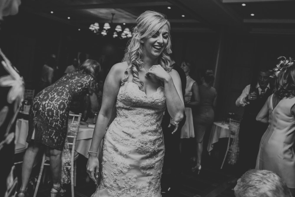 Bride laughing on dance floor.