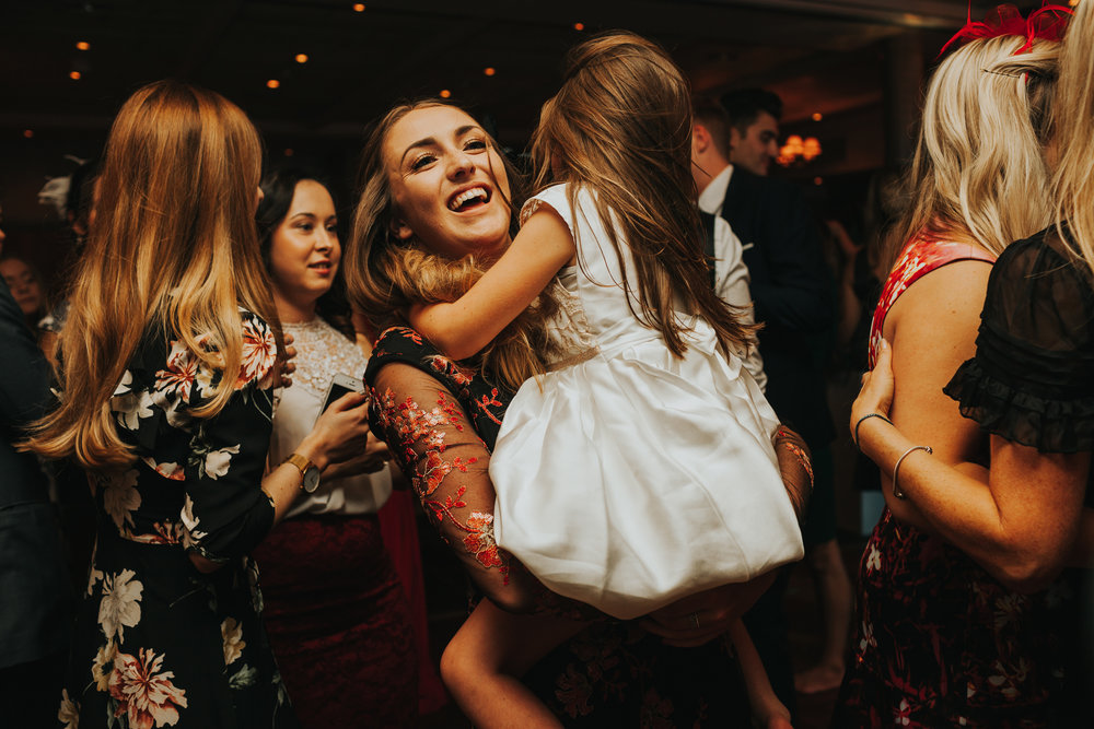Mum and child on dance floor laughing.