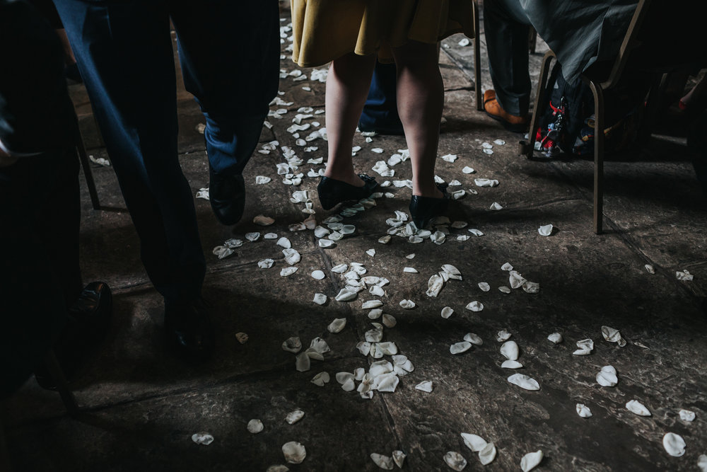 Petals lining the aisle at Chetham's Library.