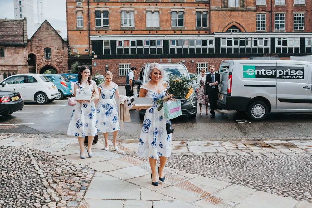 Bridesmaids arrive at Chetham's Library Manchester.