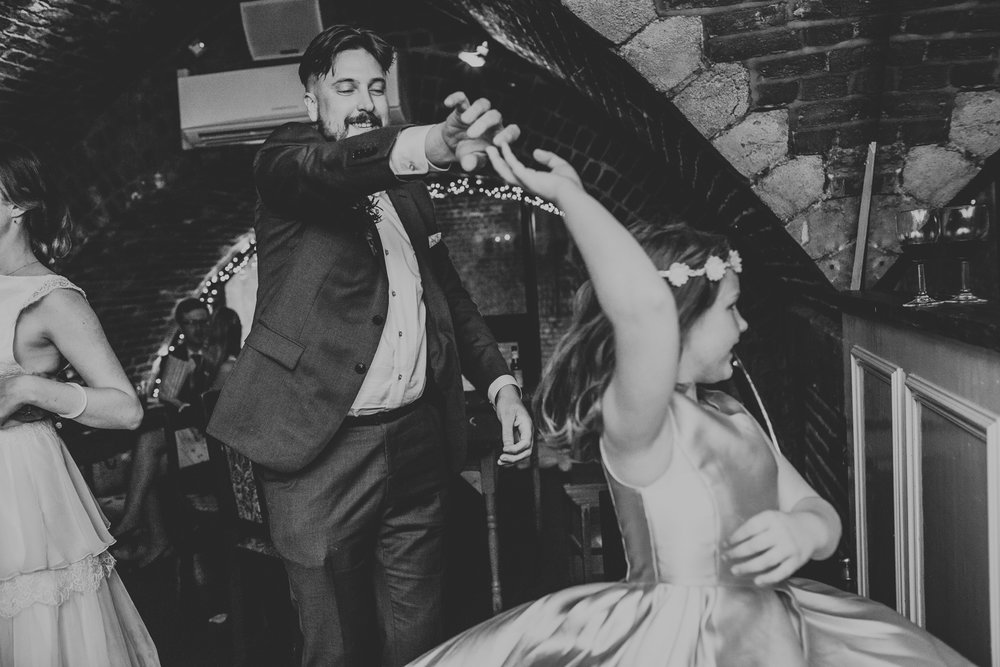 Groom dances with his daughter.