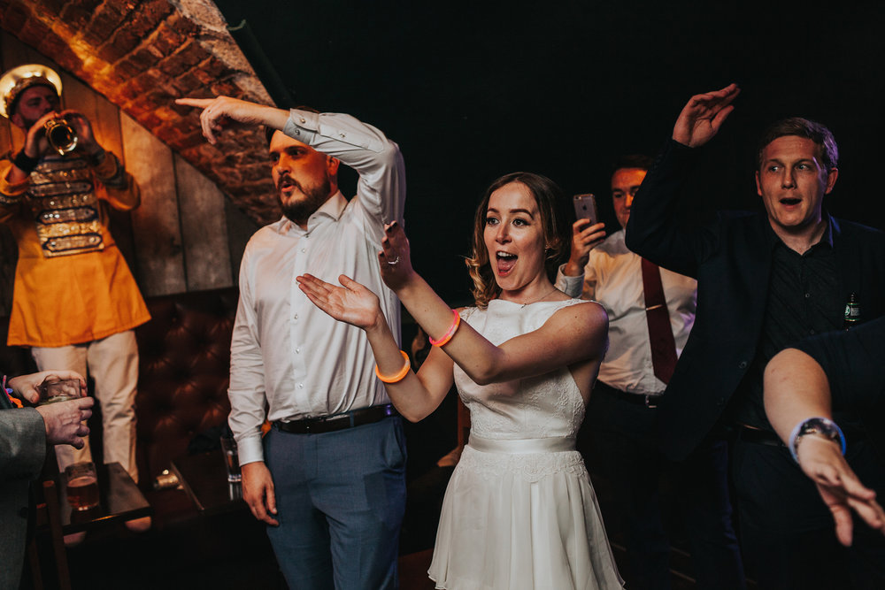 Bride and Groom throw some shapes at Lock 91 Wedding Reception.