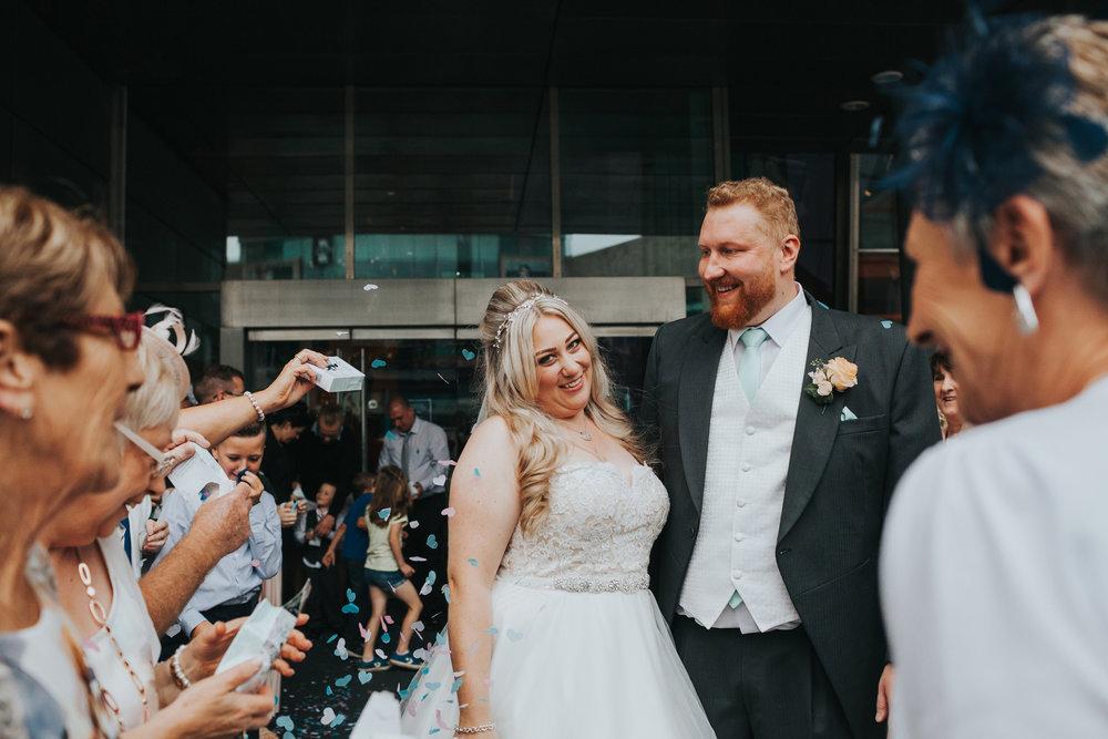 Bride looks at camera smiling.