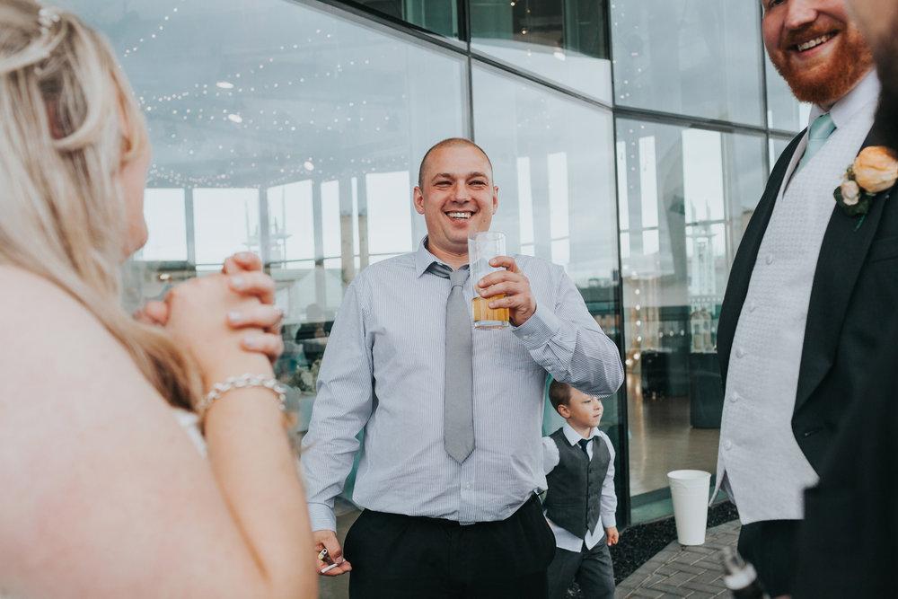 Wedding guests enjoy a drink.