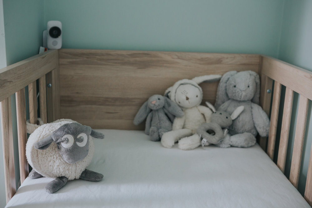 Teddies in cot.