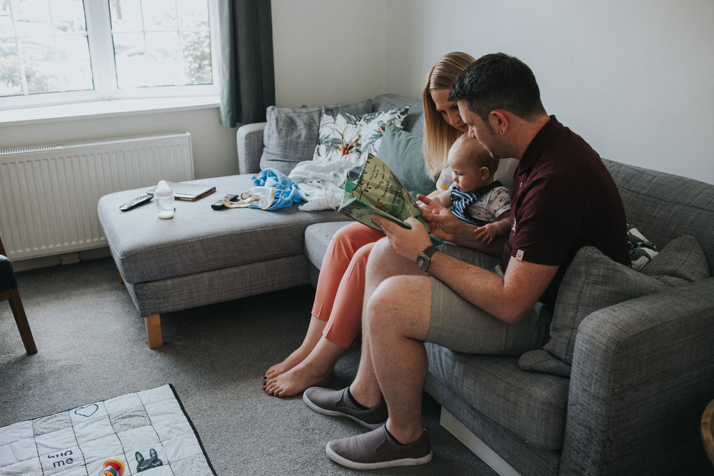 Long shot of family reading story.